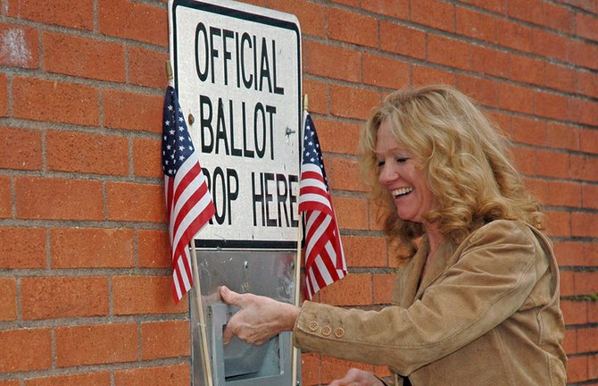 Alice Clark casts her ballot on her to work on election day. By late morning on November 6, around 74 percent of Hood River County ballots had been turned in.