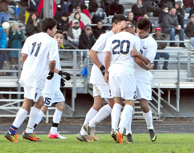 Jaime Frias (No. 20) is congratulated by Danny Romero after scoring HRV's second goal against Wilsonville, November 10, 2012.