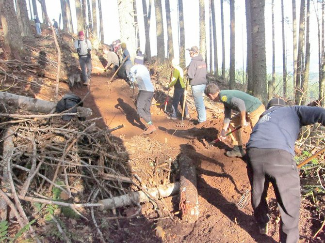 A Saturday work party brought nearly 100 volunteers to the county's Northwest Trails Area near Post Canyon to repair or replace trails damaged by storms and salvage logging.