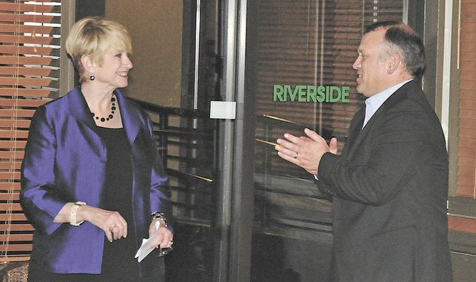GORGE Commission Exeuctive Director Darren Nichols, right, congratulates Joyce Reinig Tuesday.