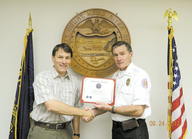 Marj Van Voast, left, and deputy State Fire Marshal Ted Megert.