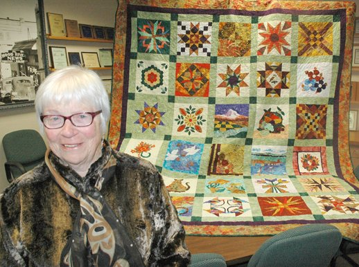 Jean Harmon and the 2012 Harvest Festival quilt, a virtual panorama of scenes and landmarks of Hood River County and the Gorge,