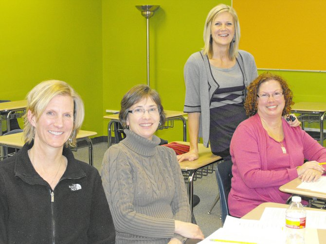 Volunteer judges for EA last year included (from left) Mary Jensen, Michelle Redmond and Debbie Dorich, with EA coordinator Wendy Herman.