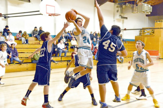 Cullen Bryant drives to the hoop for the Hood River Middle School Panthers in Wednesday afternoon's HRMS vs. Wy'east Middle School matchup. HRMS won the nail-biter 26-23, but Wy'east has a chance at revenge on their home turf in a rematch Dec. 13 at 4 p.m.
