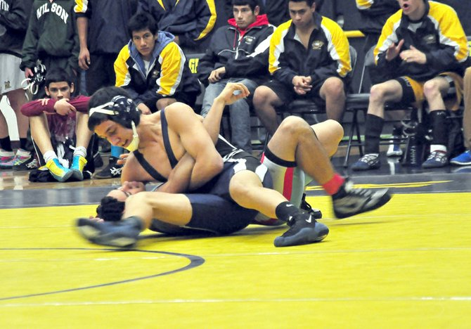 Christian Marquez gets one of his two pins Friday night.