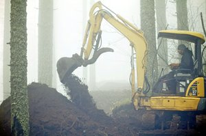 Gary paasch uses a piece of machinery (courtesy of Your Party & Rental Center) to build the rough dimensions of a new trail in the Post Canyon area. Paasch and a large number of other volunteers and trail adopters have done an impressive amount of work to build and maintain the network of trails on Hood River County Forestry property.