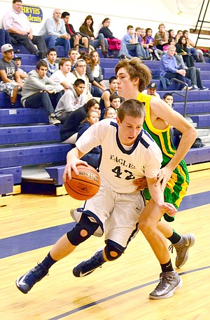 Ryan wheat picks up a foul on his way to the hoop Tuesday evening against Cleveland.