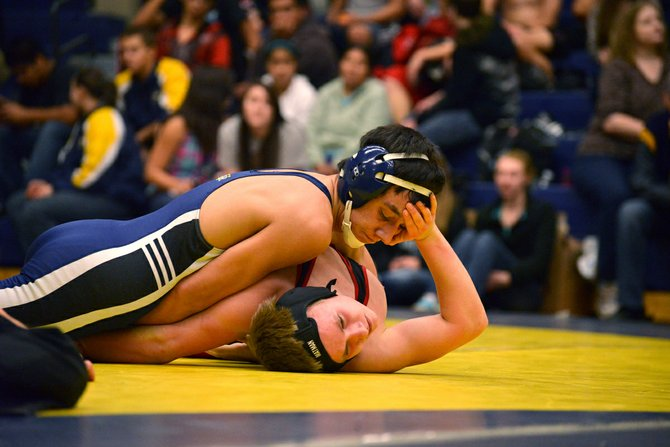Wrestler Christian Marquez pins his opponent.
