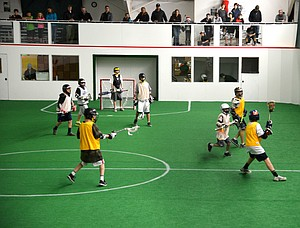 Youth lacrosse players take advantage of the new indoor turf field at The Dalles Sports Club.