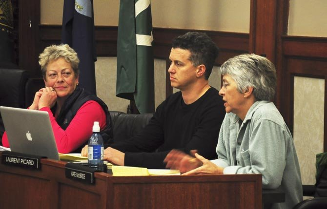 HOOD RIVER council members Carrie Nelson, Laruent Picard and Kate McBride discuss the proposed Walmart expansion Thursday. Hood River News photo