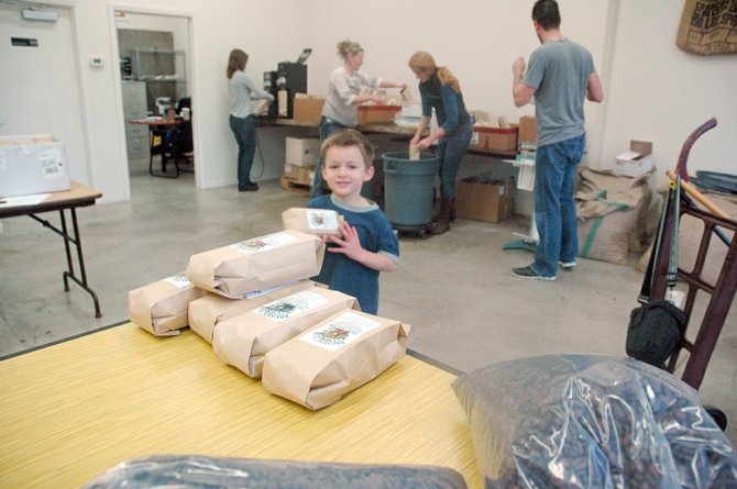 FUTURE May Street student Max Graves, 4, helps get coffee ready at Pacific Rim Coffee, owned by his father, Brian.
