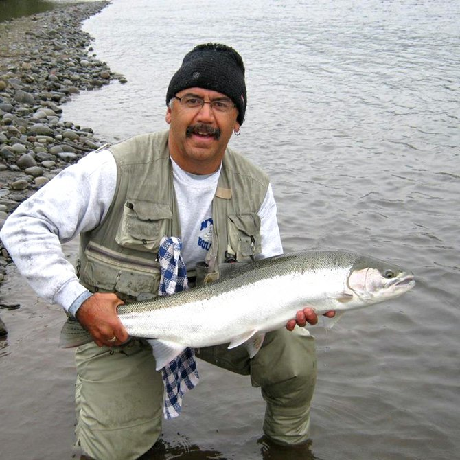Nice catch: Ernie Delgado hooked this steelhead just outside downtown Hood River.
