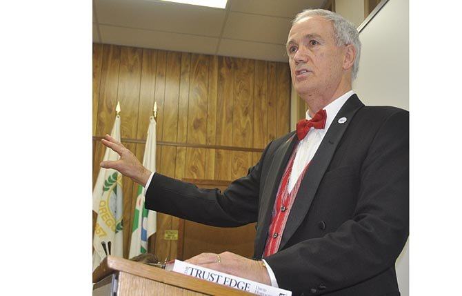 The Dalles Mayor Jim Wilcox delivers  his farewell speech at the final council meeting of his term. 	 RaeLynn Ricarte photo