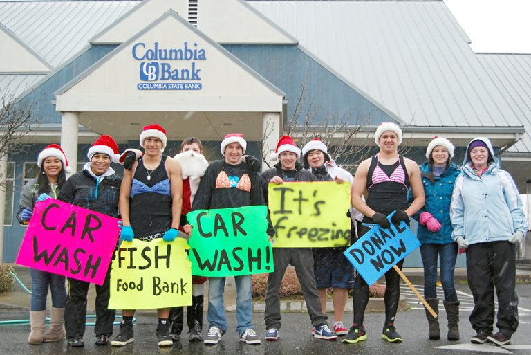 BIKINIS in December drew a solid crowd of cash donors and car wash patrons during HRVHS teacher Nan Noteboom's Writing 121 class fundraiser for FISH food bank on Sunday. Braving the snowy weather at Columbia State Bank were: (left to right) Monica Marquez, Cristina Silva, Connor Normand, Hayden Miller, Connor Webb, Wells Bishop, Eric Hamada, Eli Fults, Sierra Windsor and McKenna Carter. The crew took in about $300 in two hours. Donations are still being collected at the high school and around town. To help to a particular class, donate by Dec. 19. Additional cash or cans will be accepted at the front office through Friday. FISH food bank hopes the predictions of snow throughout the week will not slow down the donors.