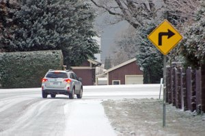 SLOW FOR CURVES, intersections and shaded roadways where ice and slush increase sliding possibilities.