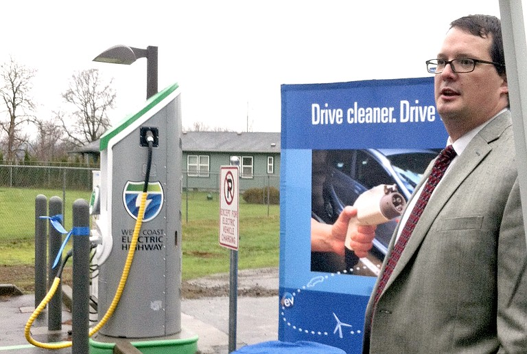 CASCADE LOCKS MAYOR Lance Masters welcomes a caravan of electric vehicles to the Dec. 15 ODOT dedication ceremony of a new electric car charging station in Cascade Locks. The station is one of a network now being established throughout the state.