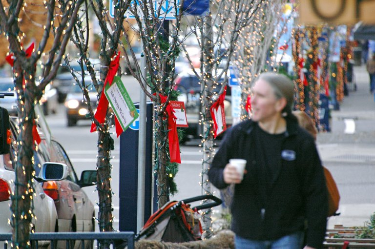 GIFT CARDS say thanks to businesses that paid for lighting on downtown trees.