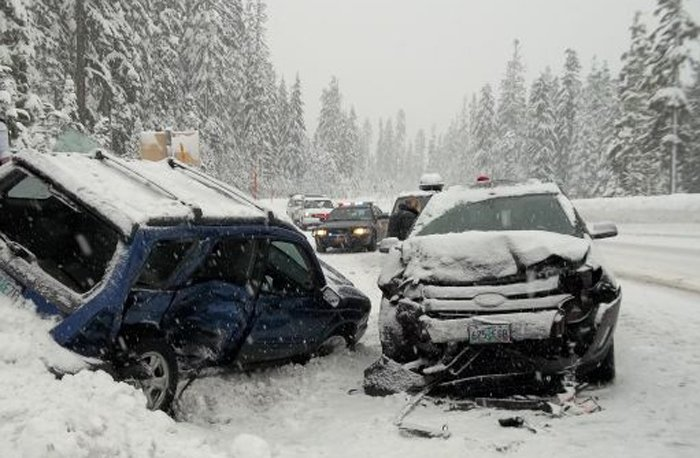 FRESH SNOW covers vehicles involved in the Highway 35 fatality on Dec. 23.