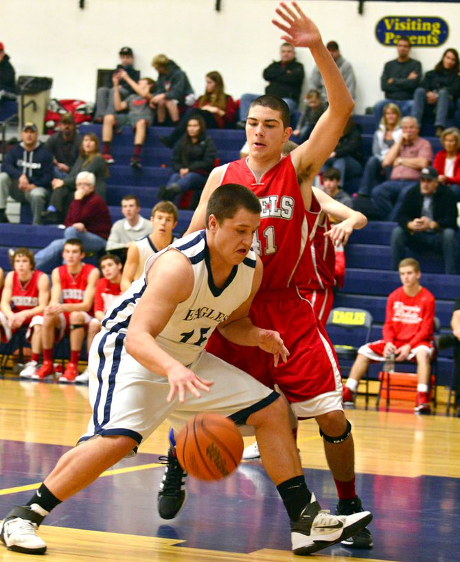 Seth Fults drives looks for space against a South Albany defender.