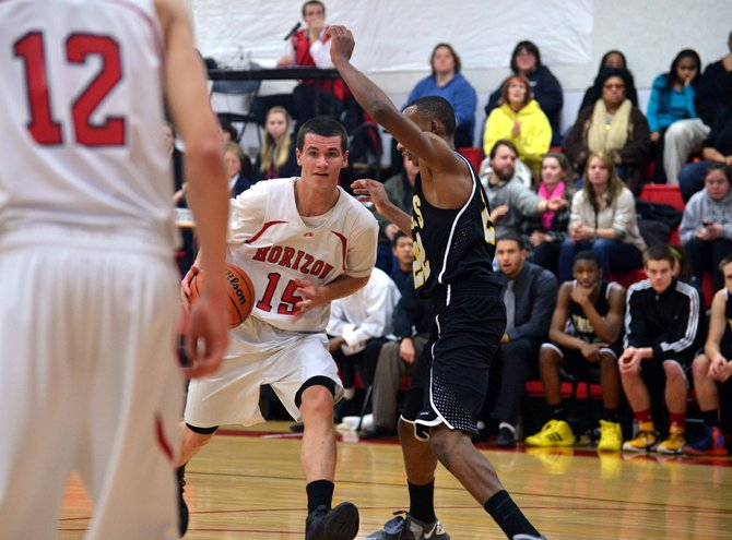 Matt Totaro drives to the hoop against Columbia Christian during the 2012-13 basketball season.