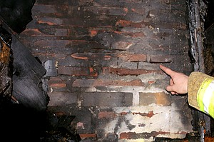 Potentially deadly cracks in the chimney masonry led to a fire in the attic space of a Sherman Avenue home on Sunday.