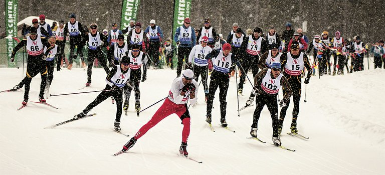 A crowd of racers breaks free from the starting line of Saturday's 15K race at Mt. Hood Meadows.