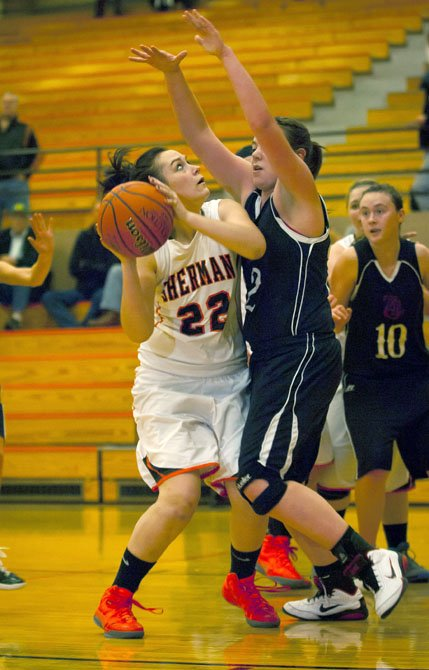 Sherman senior Brooklyn Sandquist goes for two during Tuesday's game against Troutlake/Glenwood in Moro.
