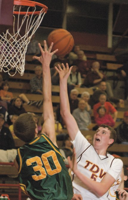 The Dalles Wahtonka sohpomore Grayson Byers, right, shoots over Pendleton junior Tyler Anderson late in Friday's game in The Dalles.
