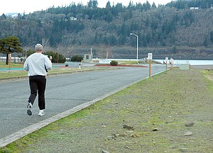 MORNING JOGGER uses Front Street next to the boat basin, where the trail extension could go.