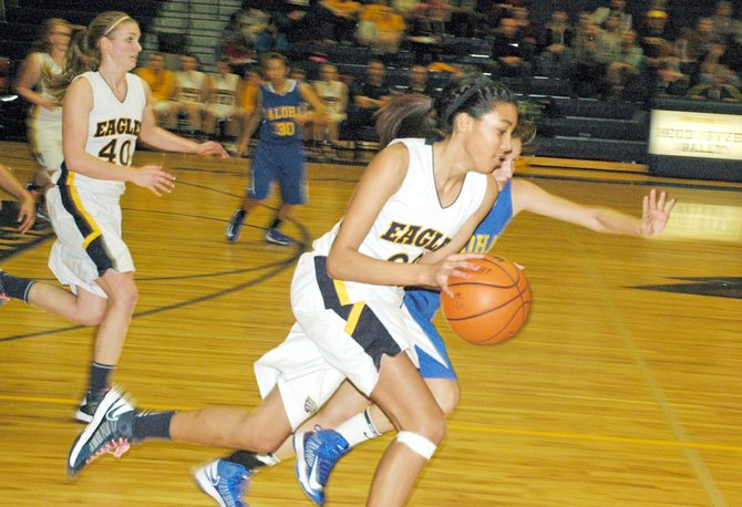 Fast break: Jestina Mattson heads upcourt with speed past a pressing Aloha player. 