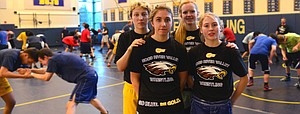 Marina Smith, Payton Rigert, (front) MaKenna Sullenger and DeHart at practice this week. The four are helping build on a growing tradition of tough girl wrestlers at HRVHS.