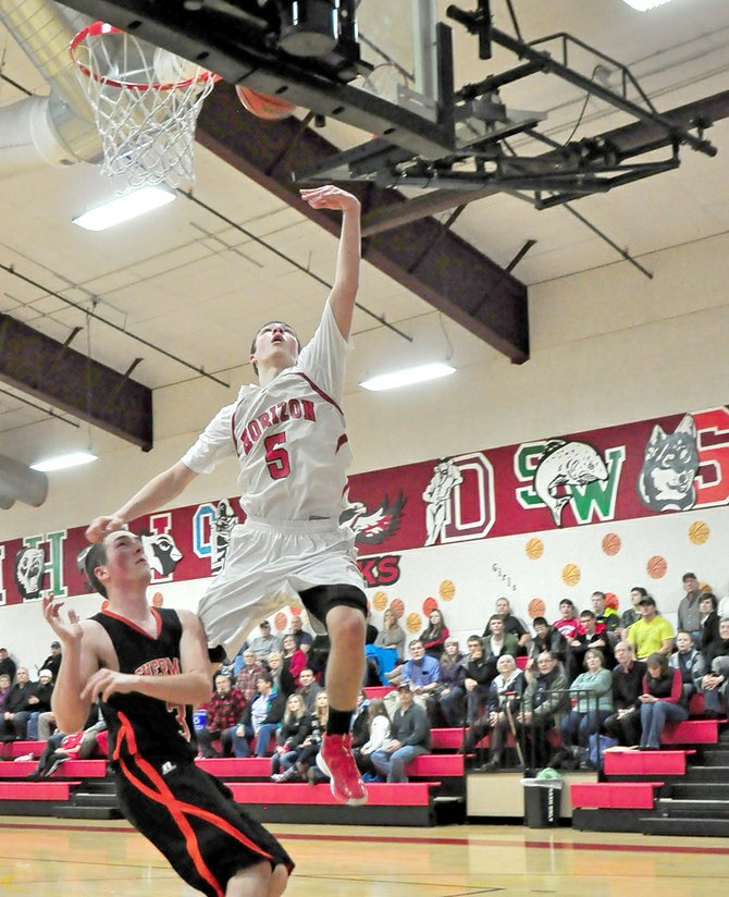 Micah Engel soars over a Sherman defender for two of his four points on the evening. 