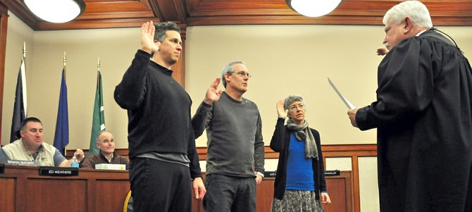 JUDGE Will Carey administers the oath of office to Hood River City Council members Laurent Picard, left, Mark Zanmiller, and Kate McBride.