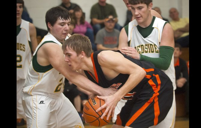 South Wasco junior Tucker Nannini, left, fouls Sherman senior Brian Simantel during the first half of Saturday's game in Maupin. Mark B. Gibson photo