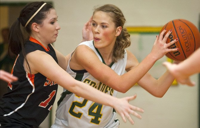 South Wasco senior Rebecca Morelli, right, looks to make a pass around Sherman defender Audrey Keseberg during Friday's game in Maupin. Mark B. Gibson photo