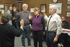 Cascade Locks Council members left to right Randy Holmstrom, Glenda Groves and Bruce Fitzpatrick take the oath of office, led by Justice the Peace Cindy Mitchell.