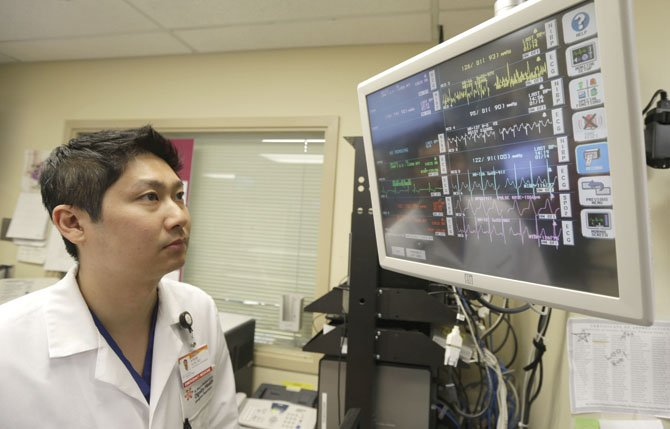 Dr. Steve Sun looks over a heart monitor display in the emergency room at St. Mary's Medical Center in San Francisco. A new government report shows the number of people seeking emergency treatment after consuming energy drinks has doubled nationwide over the last four years. AP Photo/Eric Risberg