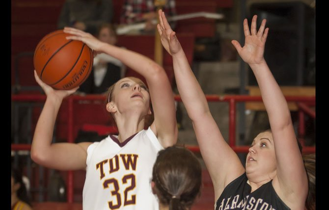 The Dalles Wahtonka sophomore Olivia Starks, left, puts a shot over Hermiston senior Heidi Walchli, left, and senior Gabby Heehn in the final quarter of Tuesday's game in The Dalles. Mark B. Gibson photo