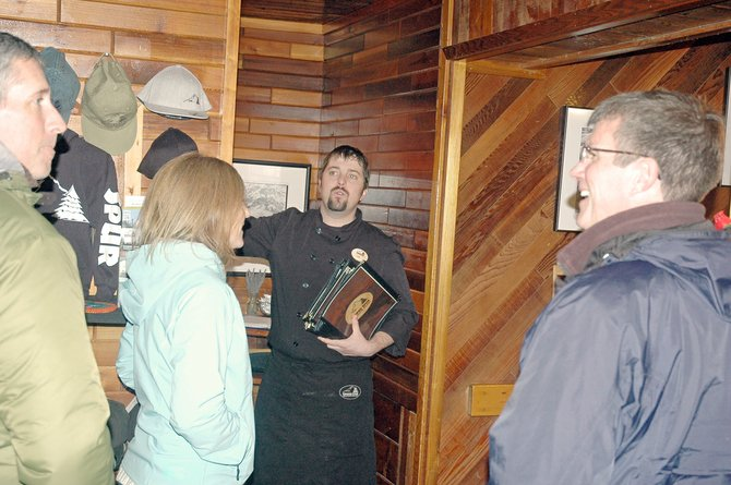 Chef Joe Silliman welcomes the first of about 50 guests for Thursdays dinner to benefit Parkdale Elementary School.