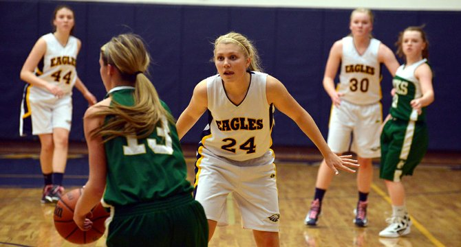 Hallie Curtis, Sophia Oswald and Waller stay tight on defense to limit Pendleton's second-quarter scoring in the Eagles' Columbia River Conference opener.