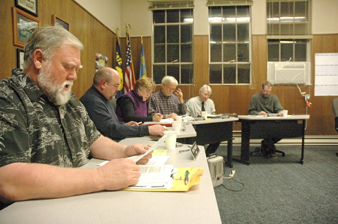 The Cascade Locks city council at its first meeting of 2013. From left to right are Mayor Tom Cramblett, Mark Storm, Glenda Groves, Randy Holmstrom, Bruce Fitzpatrick and Brad Lorang. Storm, Holmstrom and Lorang all resigned over the weekend, leaving the council with three members and four vacancies to fill.