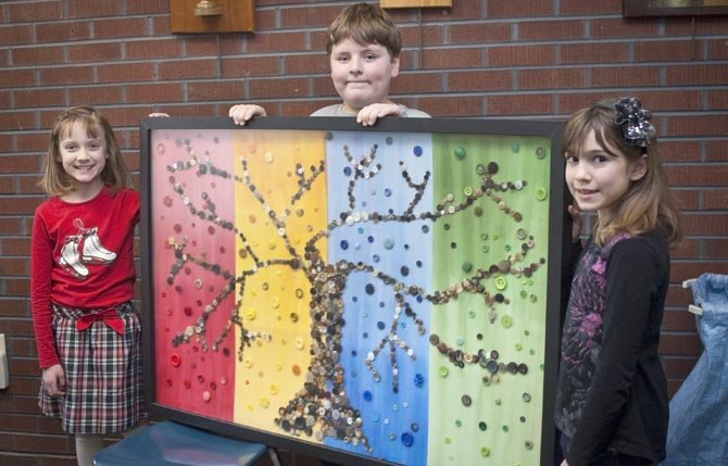 PICTURED WITH some auction artwork are third graders, left to right, Caitie Wring, Colin McLoughlin and Madeline Dollarhide. 	Mark B. Gibson photo