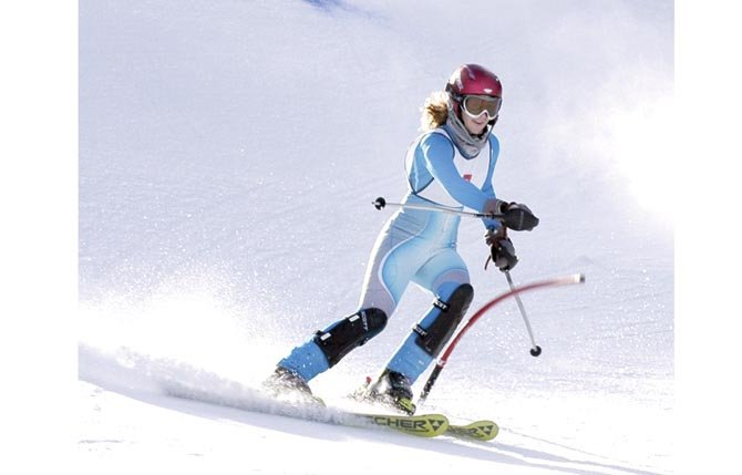 THE DALLES WAHTONKA senior Maya Barnard-Davidson cuts through the flag while making a run on the SL Cascade Course at Ski Bowl. In two races this season, Barnard-Davidson has a pair of top-3 finishes to lead the girl's team.                   Ray Rodriguez photo