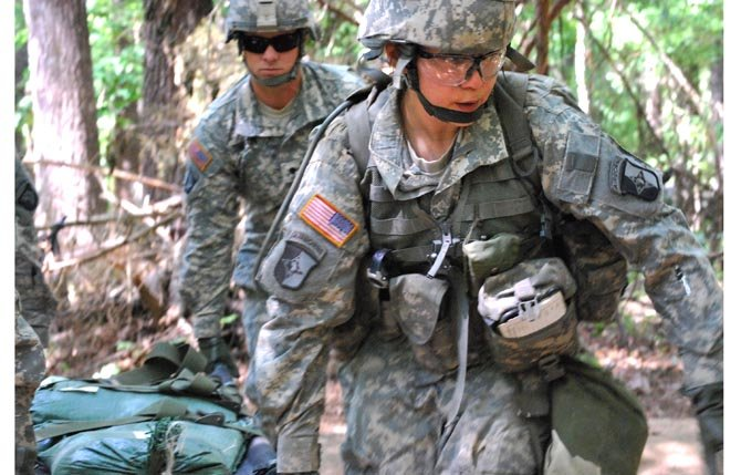 Capt. Sara Rodriguez, 26, of the 101st Airborne Division, carries a litter of sandbags during the Expert Field Medical Badge training at Fort Campbell, Ky. in this May 9, 2012 file photo. The Pentagon is lifting its ban on women serving in combat, opening hundreds of thousands of front-line positions and potentially elite commando jobs after generations of limits on their service, defense officials said Jan. 23.AP Photo/Kristin M. Hall, File