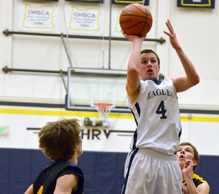 Luke Kopecky drives to the hoop against Hermiston.