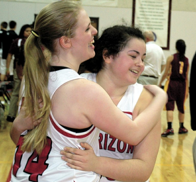 Celebrating the Horizon girls' second league win of the season Saturday are Katie Tolbert and Kasia Neilsen.