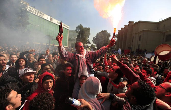 Egyptian soccer fans of Al-Ahly club celebrate a court verdict that returned 21 death penalties in last years soccer violence, inside the club premises in Cairo, Egypt, Saturday, Jan. 26, 2013. Egyptian security officials say military to deploy in Port Said after at least 8 people including a senior police officer and a policeman were shot dead in the Mediterranean city of Port Said after a judge sentenced 21 people to death in connection to one of the world's deadliest incidents of soccer violence. (AP Photo/Khalil Hamra)