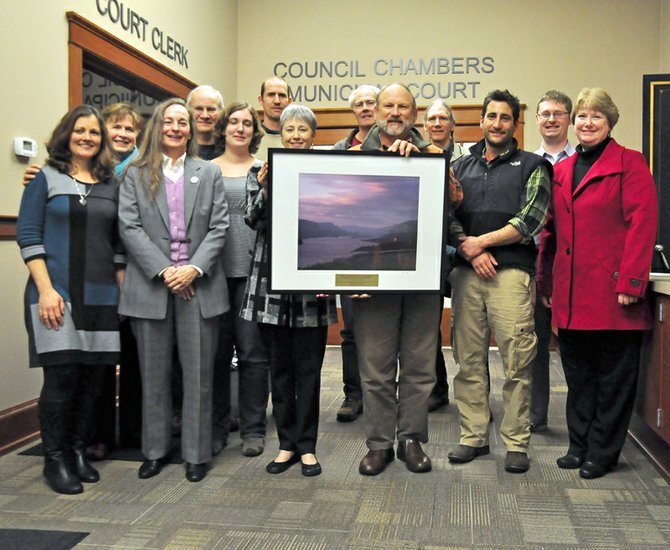 OREGON SOLVE President Amanda Black (center left) presents the organization's