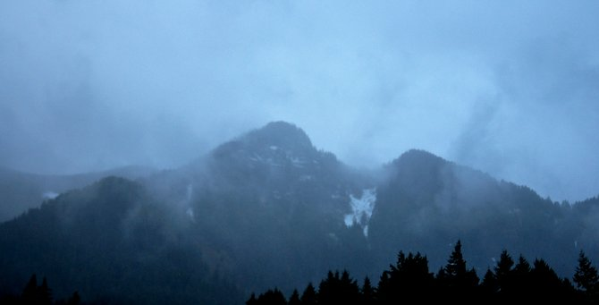 Rolling rain: Rain lashes the hills above Cascade Locks Tuesday night.