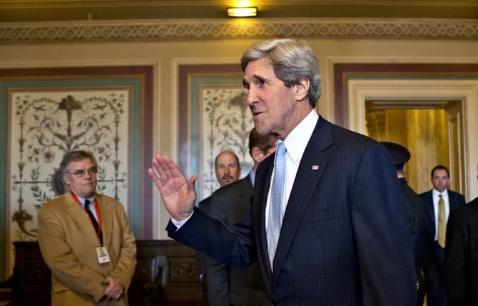 Sen. John Kerry, D-Mass., shown after a vote by the Senate Foreign Relations Committee approving him to become America's next top diplomat, replacing Secretary of State Hillary Rodham Clinton. Kerry won confirmation 94-3 in the U.S. Senate Jan. 29.  AP Photo/J. Scott Applewhite